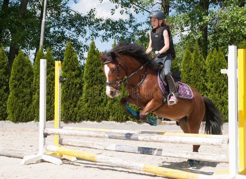 Girl practising horse riding royalty free stock images