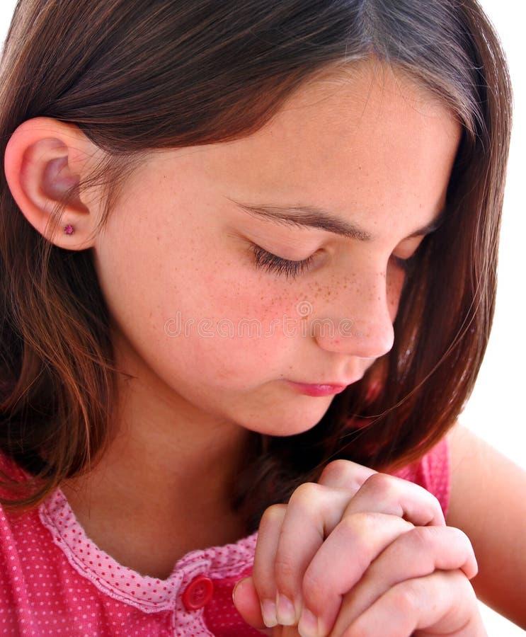Girl At Prayer stock photo