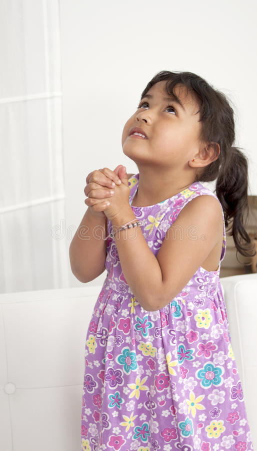 Girl prayer. Hands together in prayer with divine aura royalty free stock photography
