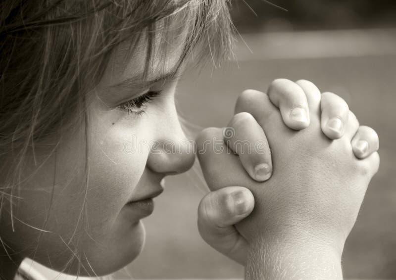Girl in Prayer stock photo