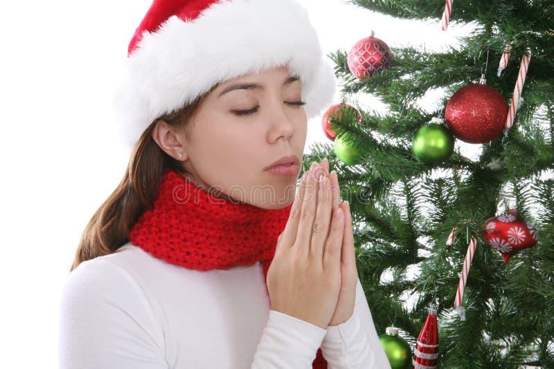 Girl Praying at Christmas stock photos