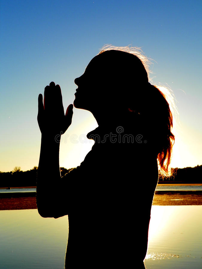 Girl Praying by Lake stock photo
