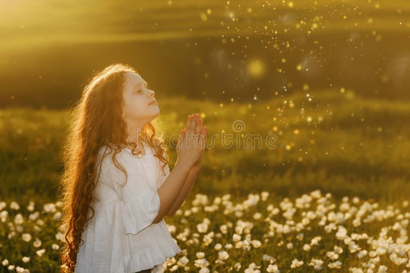 girl with praying. Peace, hope, dreams concept. stock photos