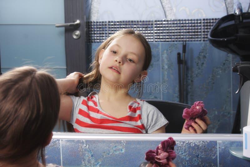 Girl preening at mirror royalty free stock photos