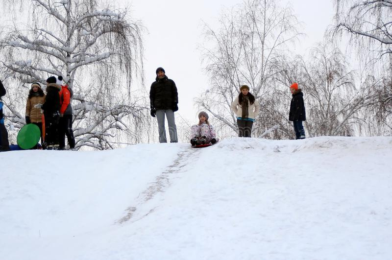 The girl is preparing to descend from the hill. stock photo