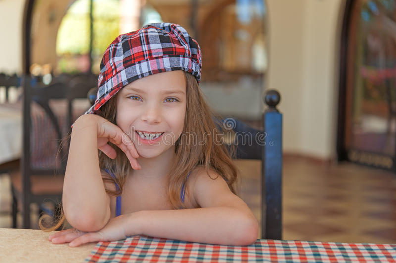 Girl-preschooler Sitting At Table Royalty Free Stock Images