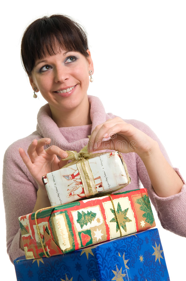 Girl with presents. Young brunette with pile of Christmas presents, looking up, isolated over white royalty free stock images