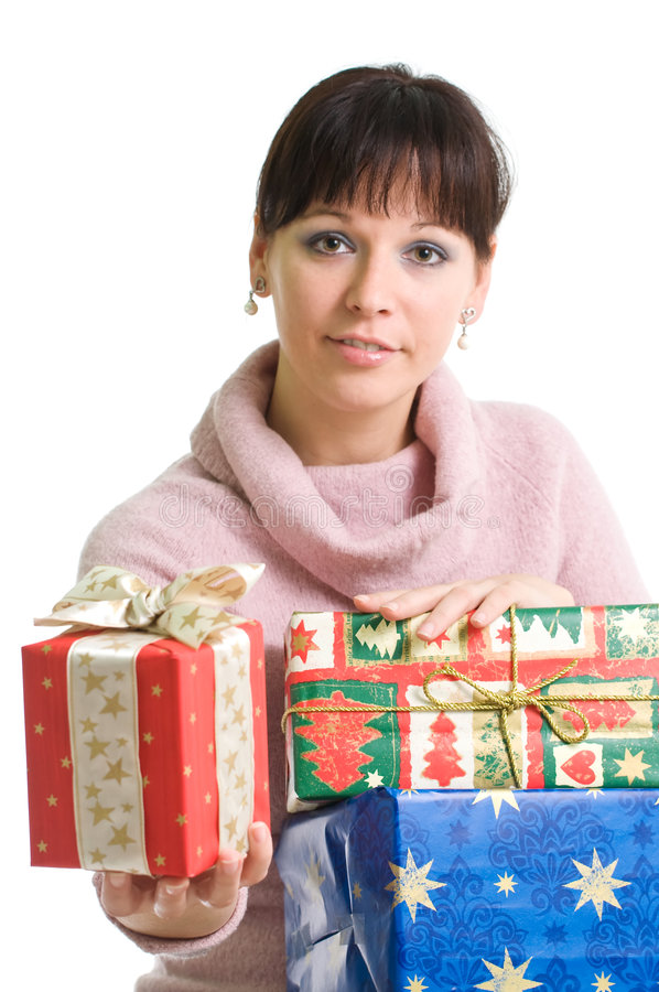 Girl with presents. Young brunette holding Christmas present isolated over white stock images
