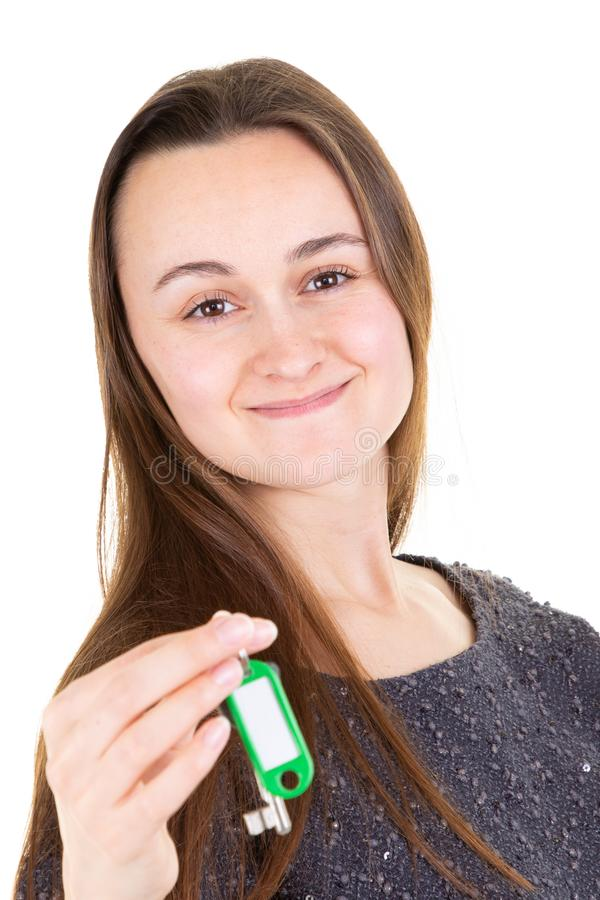 Girl pretty showing holding home house key royalty free stock photos