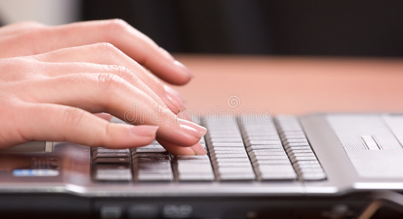 Girl prints on the laptop stock images