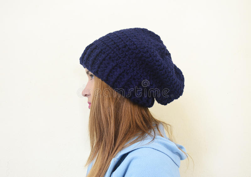 Girl profile with crochet beanie. Girl profile wearing a chunky crochet beanie royalty free stock photography