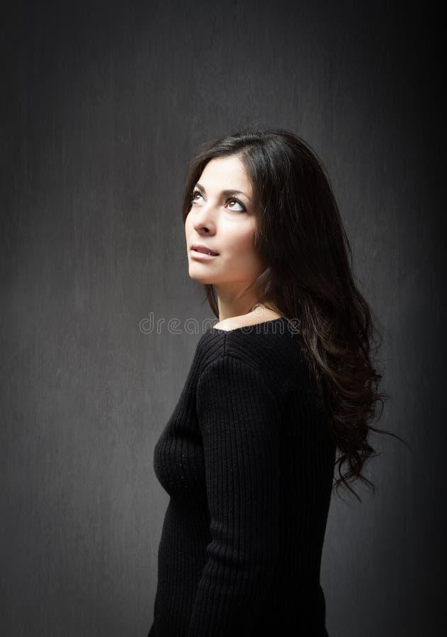 Girl in profile pose stock photos