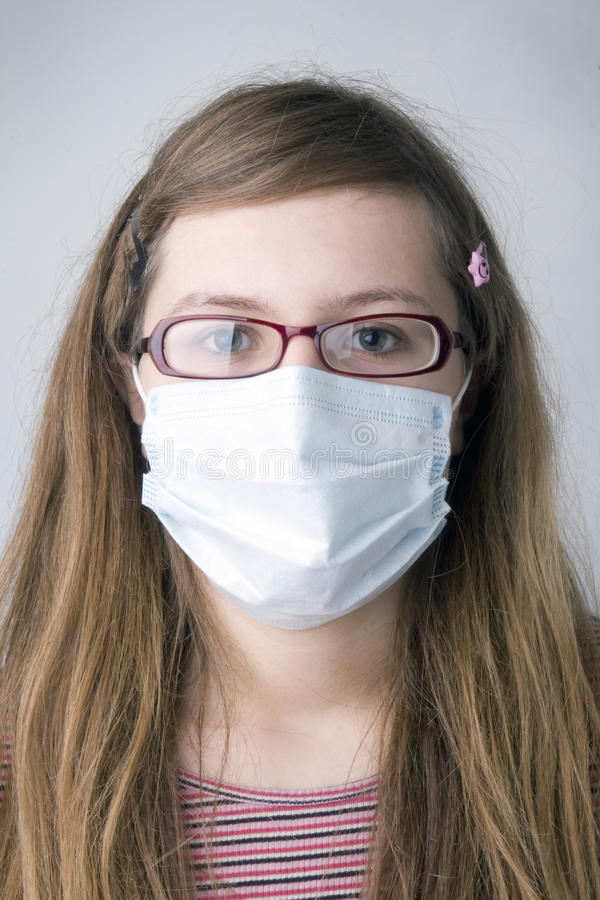 Girl with the protective mask stock image