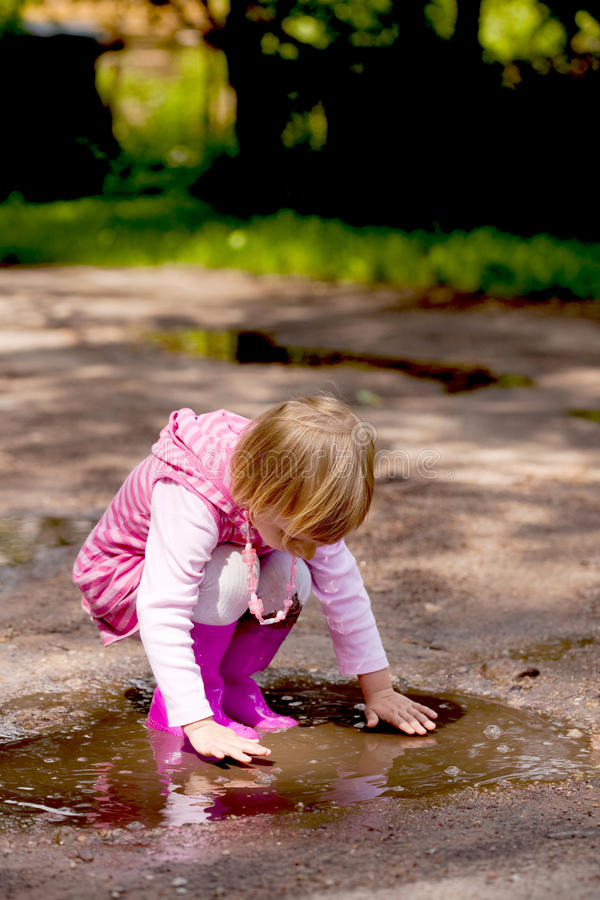Download Girl in a puddle stock photo. Image of splashing, cute - 12035540