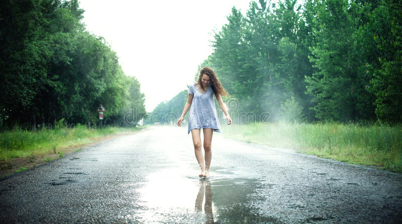 Girl in a puddle stock images