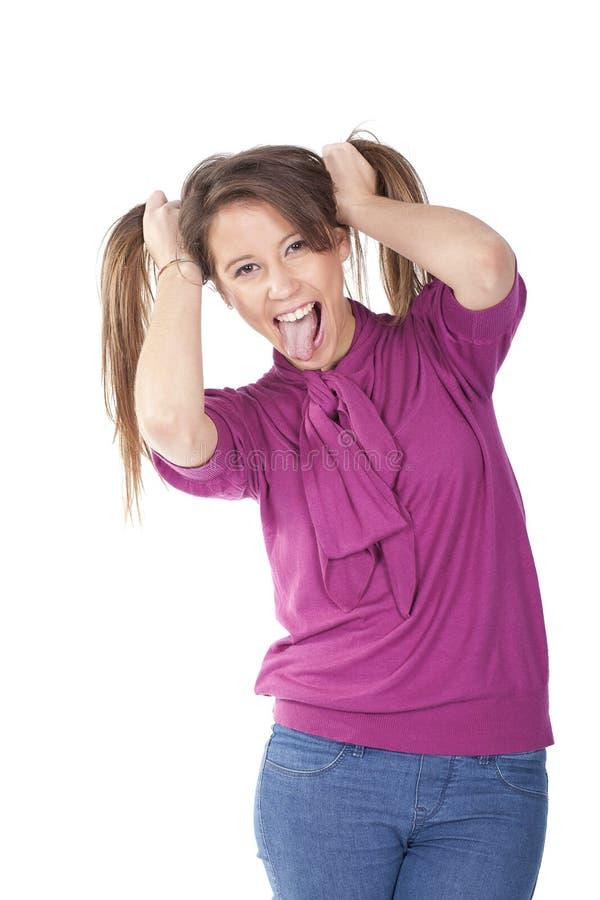 Girl pulling hair and having fun royalty free stock photos