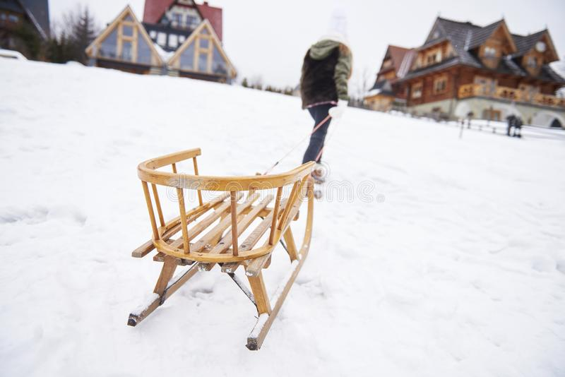 Girl pulling a sled stock photo