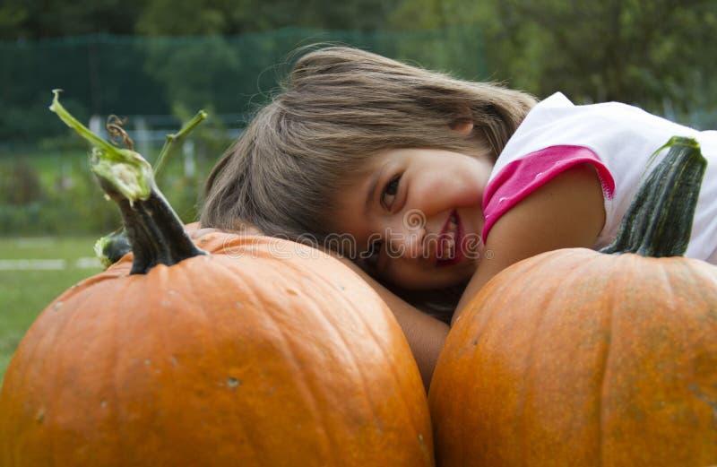 Girl with pumpkins royalty free stock photos