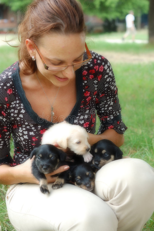 Girl with puppies stock photos