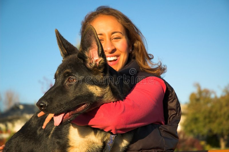 Girl and puppy stock image