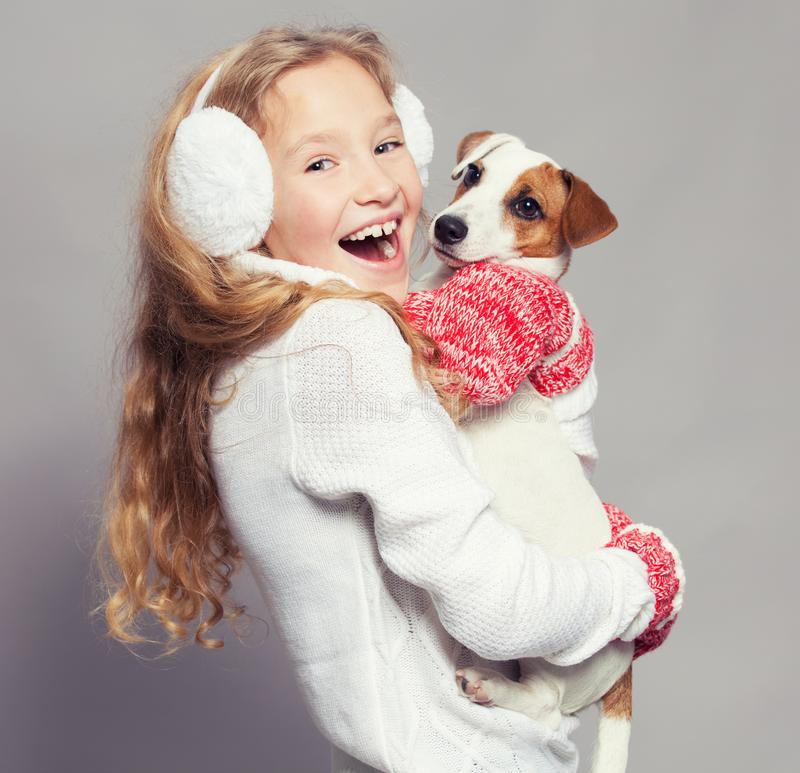 Girl with puppy in winter clothes royalty free stock photography