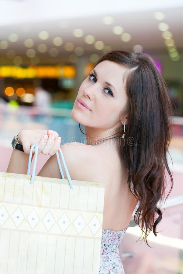 Girl with purchases royalty free stock photography