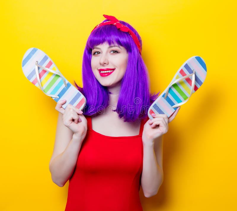 Girl with purple color hair and sandal flip flops royalty free stock images