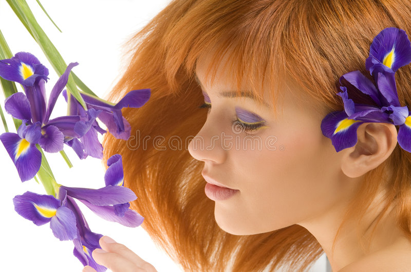 Girl with purple flower royalty free stock photography