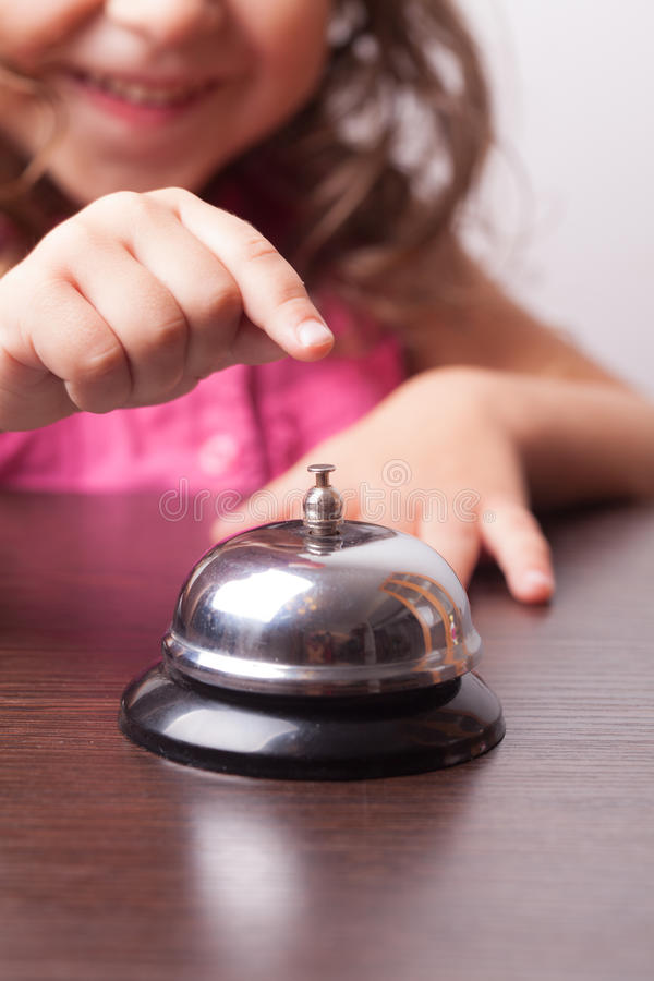 Girl push on the bell. Little pretty girl push on the bell, board game on time stock photos