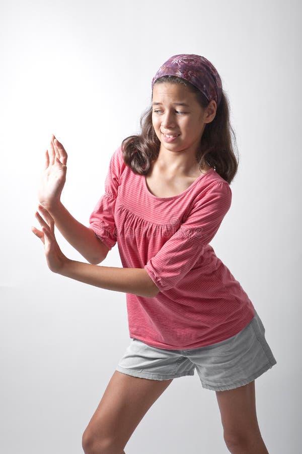 Girl pushing imaginary wall stock image