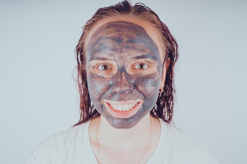 The girl put on the face mask for acne. The concept of facial stock photo