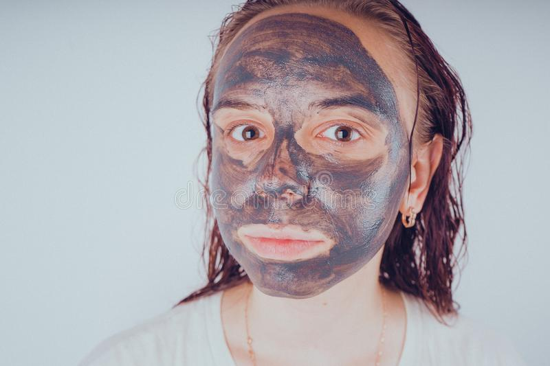 The girl put on the face mask for acne. The concept of facial royalty free stock photos