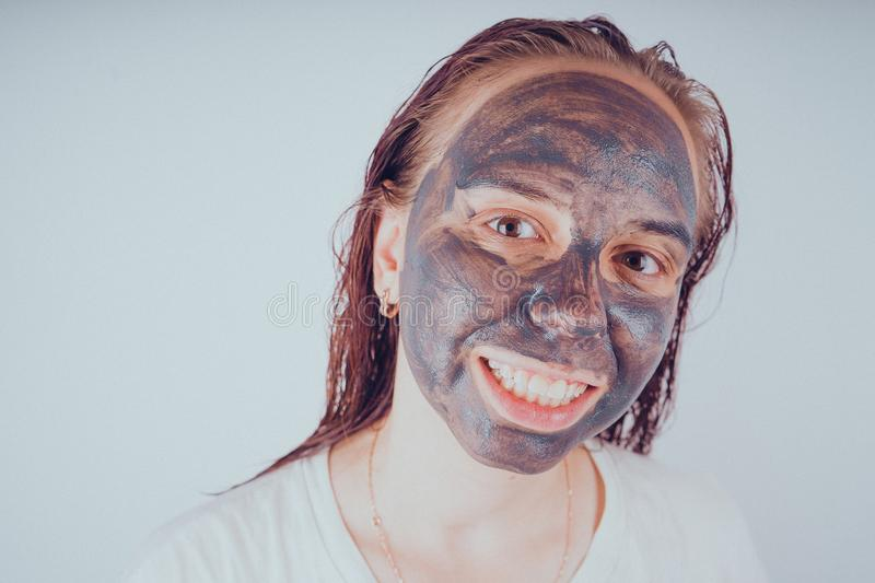 The girl put on the face mask for acne. The concept of facial royalty free stock image