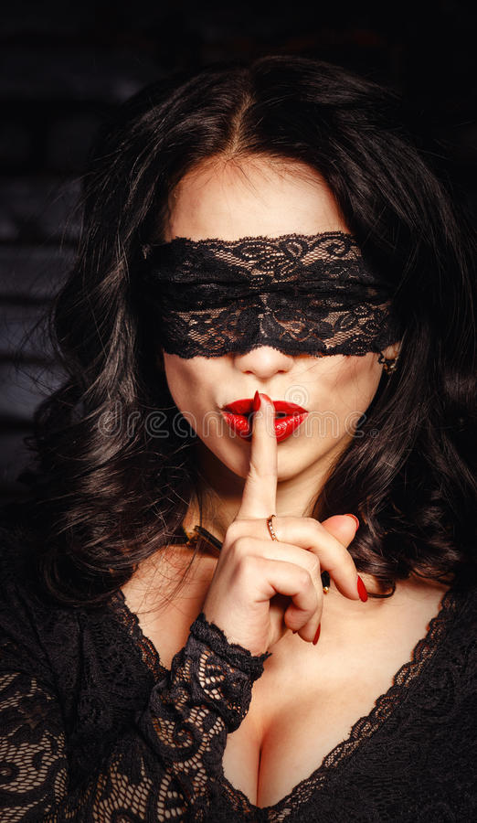 Girl put your index finger to her lips to keep silent royalty free stock photos