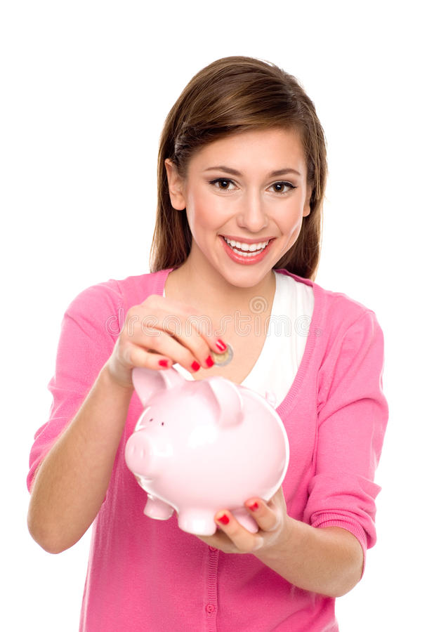 Download Girl Putting Coin In Piggy Bank Stock Image - Image: 22330483