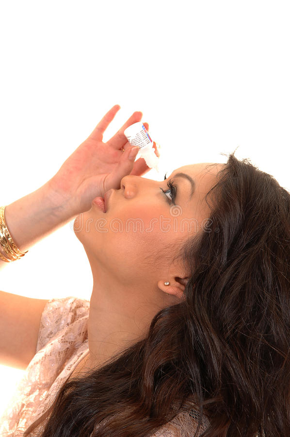 Free Girl Putting Eye Drops. Stock Images - 19036284