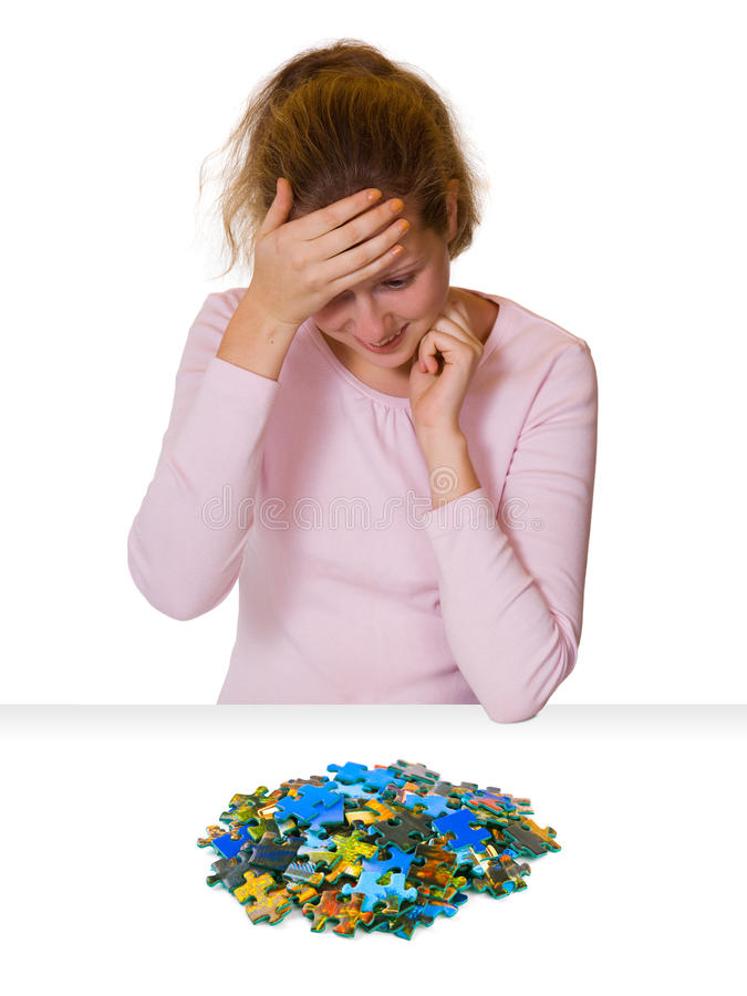 Girl and puzzle stock photography