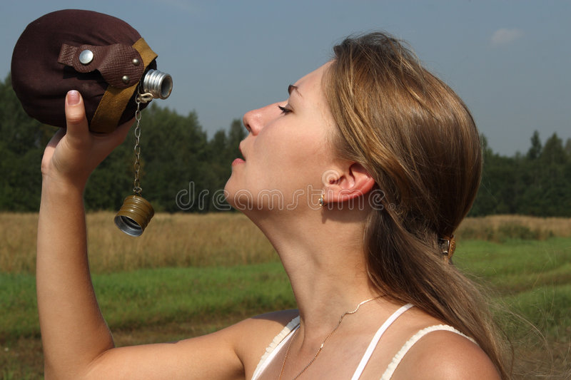 The Girl Quench Thirst Stock Photography