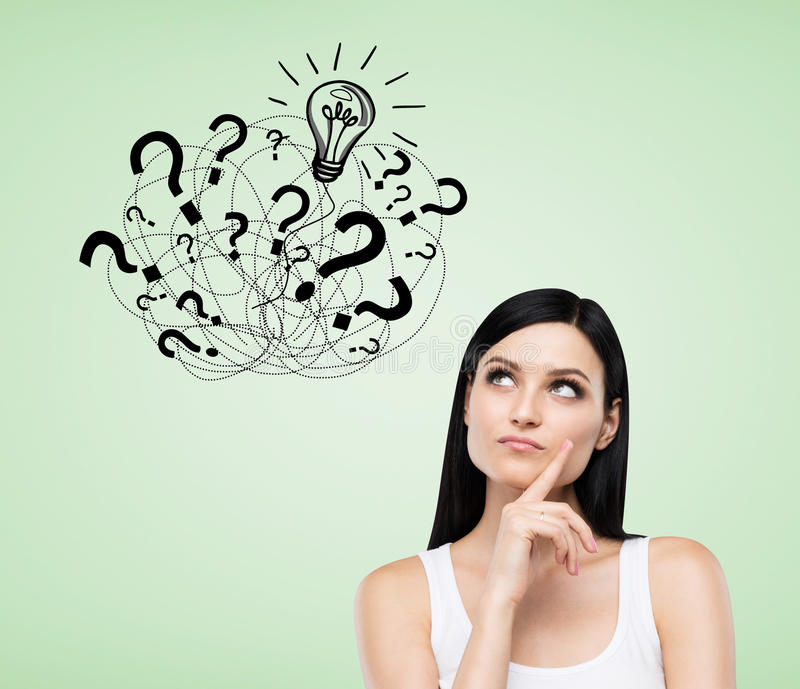 Girl with question marks on green background stock images