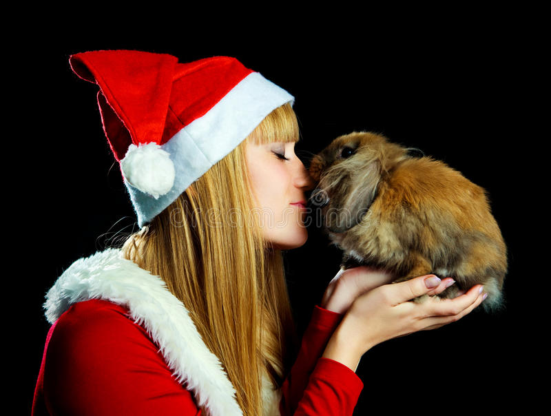 Girl with a rabbit stock images