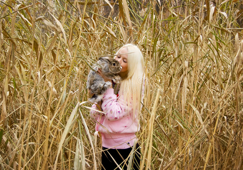 Download A girl and a rabbit stock photo. Image of whiskers, blond - 18580472