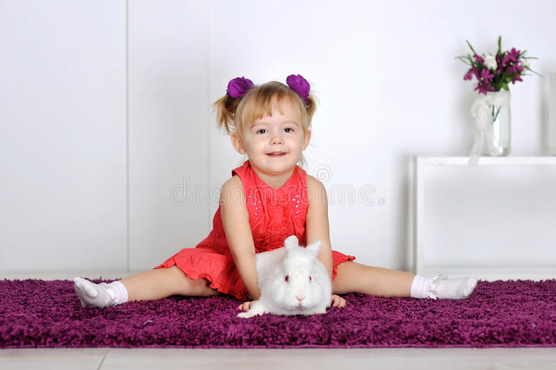 Girl and rabbit stock image
