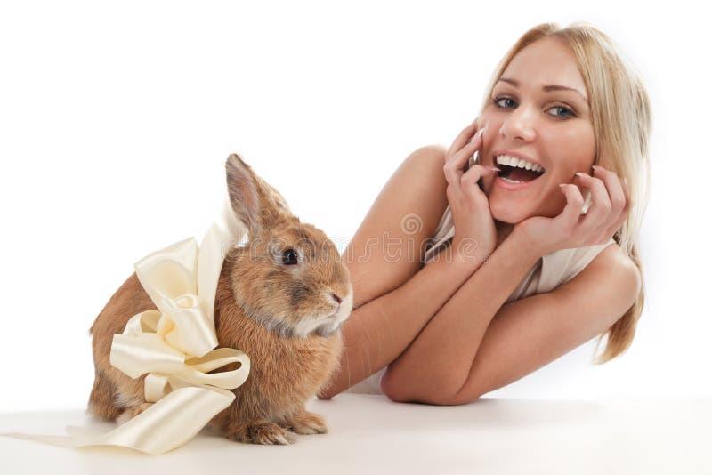 Girl With A Rabbit Stock Photos