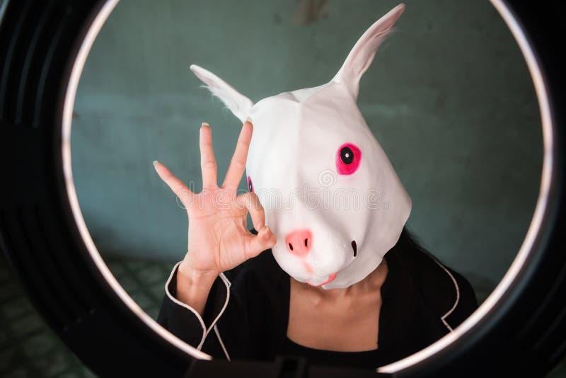 Girl with rabbit mask ok hand sign stock photos