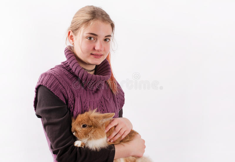 Girl and rabbit stock photography