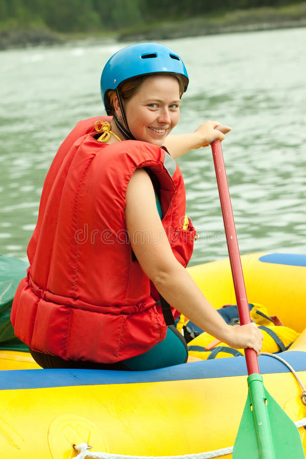 Girl on the raft. Girl with a paddle on the raft royalty free stock images