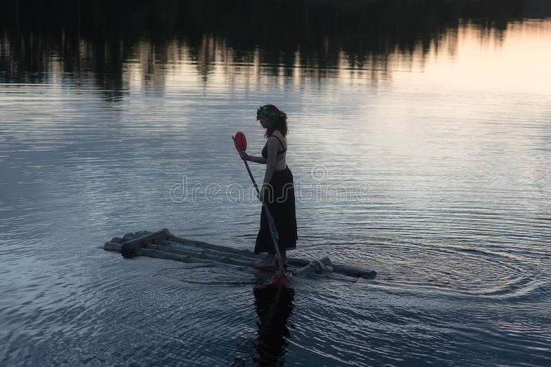 Girl on a raft royalty free stock images