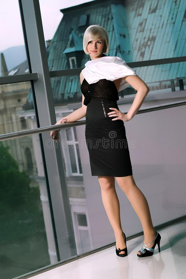 Download The Girl At The Railing In The Shopping Center Stock Image - Image: 14573191