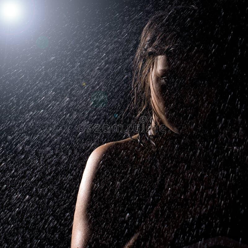 Girl in the rain. Beautiful girl in the rain stock photo