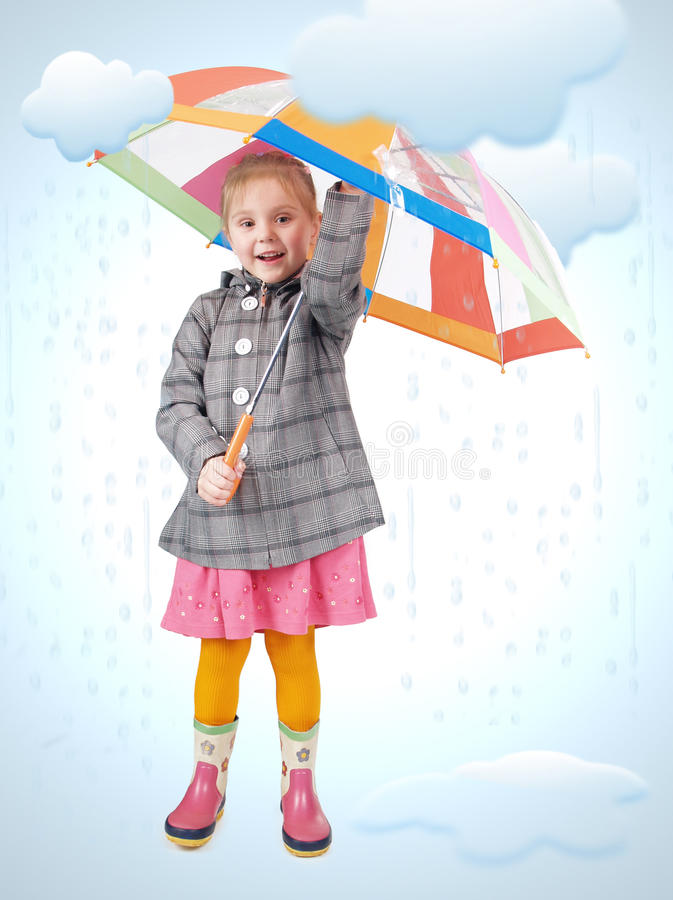 Girl in the rain. Girl standing in cartoon rain and puddles. Photo and drawing elements combined stock photos